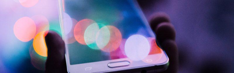 Front of mobile phone with abstract bubble lighting over top of it