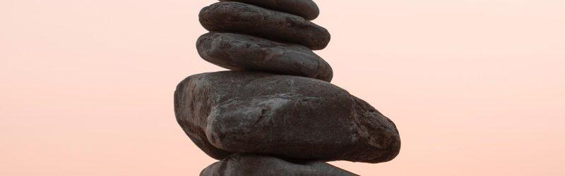 close up of a stack of stones that gradually get smaller toward the top