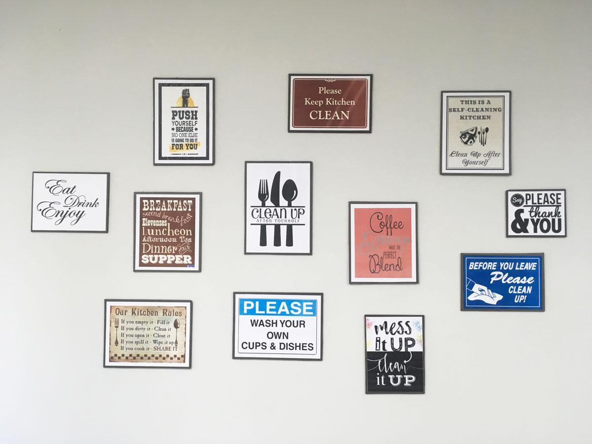 Framed images with messages against a light colored wall
