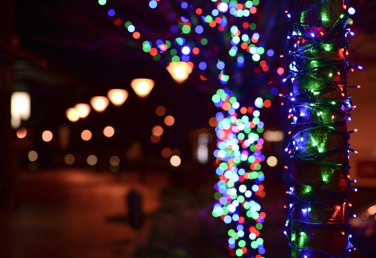 selective focus photo of colored lights on street poles